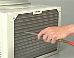 Clean the condenser coils once per season.